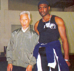 Garry McKenzie with Top Wing Chun master Leun Gai in Faat Saan. Victor J.T Appiah interviews Sifu Garry McKenzie